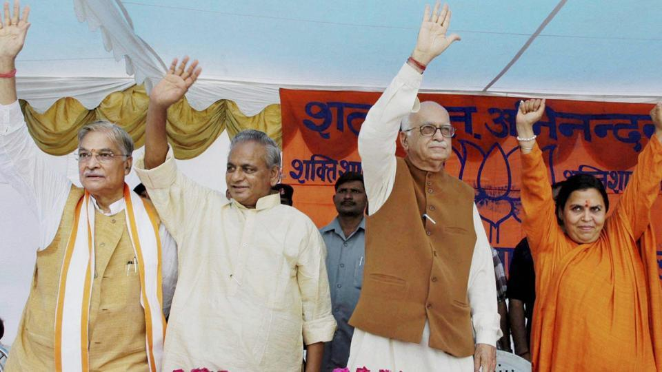 BJP leaders LK Advani, Murli Manohar Joshi, Kalyan Singh and Uma Bharti wave at the crowd at a public meeting after appearing in a special court in connection with the demolition of Ayodhya's Babri Masjid, in Raebareli, July 28, 2005.