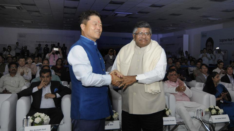 HC Hong, president and CEO, Samsung Electronics, with Union IT minister Ravi Shankar Prasad at the event in Noida.