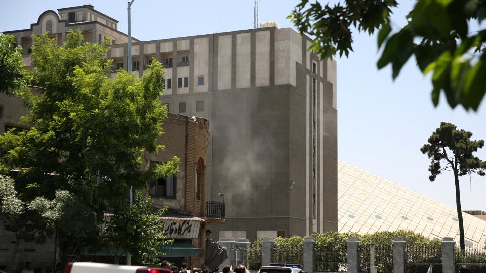 Smoke billows during a shooting and suicide explosion at the parliament building in central Tehran.  (REUTERS)