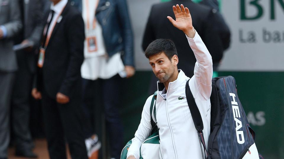 Novak Djokovic gestures as he leaves the court after losing to Dominic Thiem in the 2017 French Open quarter-finals. (AFP)