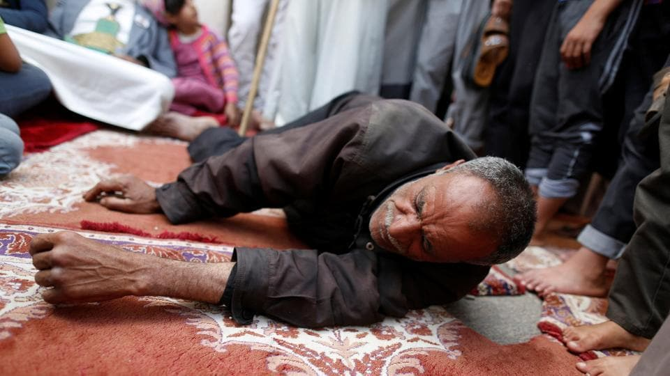 A man lies on the ground as he receives fatigue treatment during a day of fasting in Sanaa. (REUTERS)