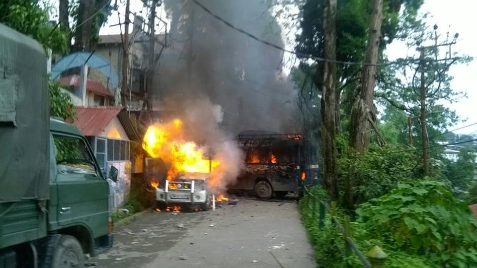 Police vehicles set ablaze by GJMsupporters in Darjeeling.