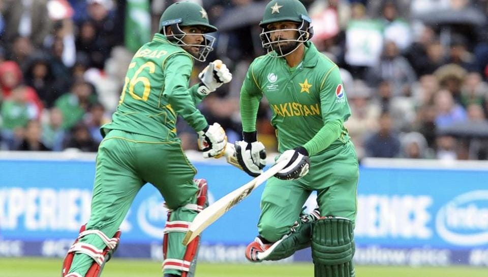 Pakistan's Babar Azam, left, and Pakistan's Mohammad Hafeez run between wickets during the ICC Champions Trophy match between Pakistan and South Africa at Edgbaston in Birmingham, England, Wednesday. Pakistan won the match to keep their knockout hopes alive.