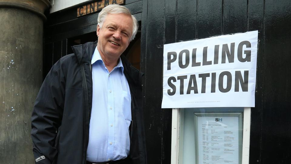 Conservative candidate for Haltemprice and Howden David Davis leaves a polling station in Howden, northeast England. (Lindsey Parnaby / AFP)