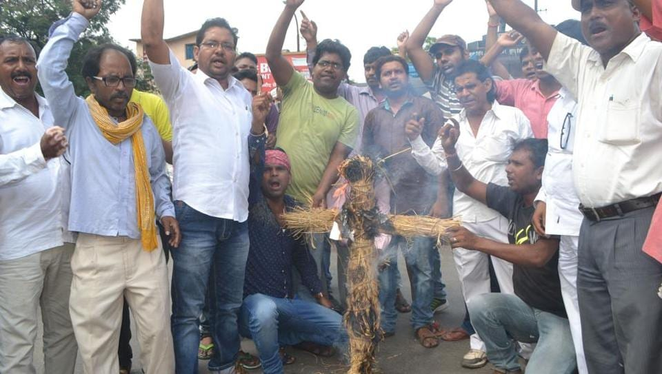 Dalit activists burn an effigy of Prime Minister Narendra Modi to protest the statue desecration in Dhanbad on Thursday.
