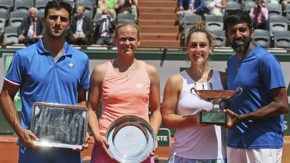 Canada's Gabriela Dabrowski and India's Rohan Bopanna, right, hold the trophy. (AP)