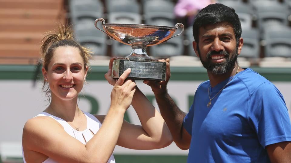 Canada's Gabriela Dabrowski and India's Rohan Bopanna hold aloft the trophy after winning the French Open mixed doubles title in Paris on Thursday. The pair defeated Germany's Anna-Lena Groenefeld and Colombian Robert Farah 2-6, 6-2 (12-10).