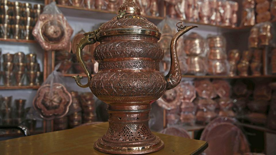 Copperware is made in Kashmir by skilled indigenous artisans.  (Waseem Andrabi/HT Photo)