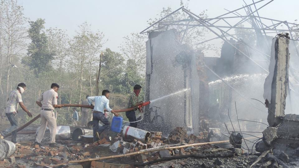 Rescuers try to douse the fire after an explosion in a firecracker factory in Balaghat in Madhya Pradesh.