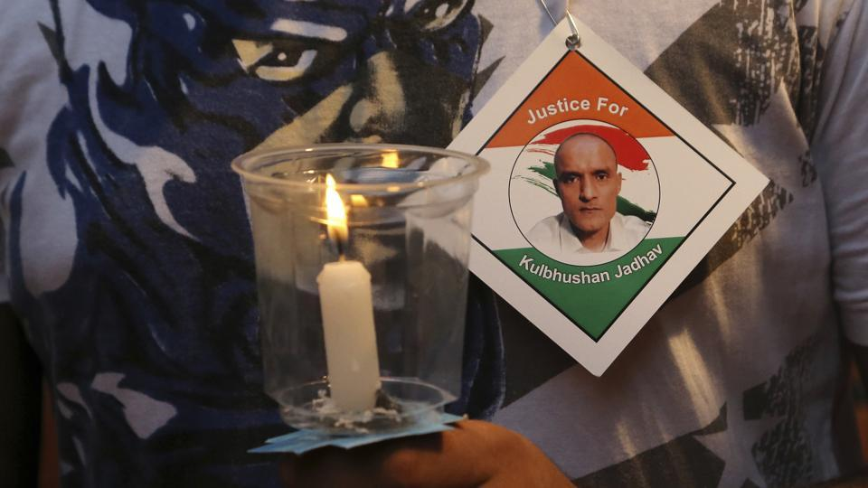 A man holds a candle as he participates in a demonstration in support of naval officer Kulbhushan Jadhav in Mumbai.