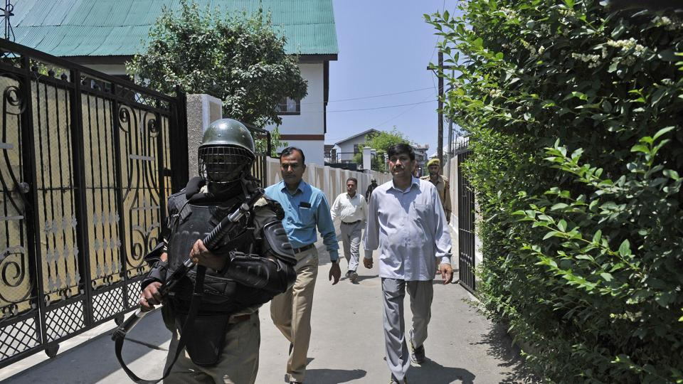NIA raided 26 places across Kashmir, Delhi and Haryana last week, allegedly recovering letterheads of Hizbul and LeT. In this photo, NIA team is seen outside the residence of a prominent businessman in Srinagar.