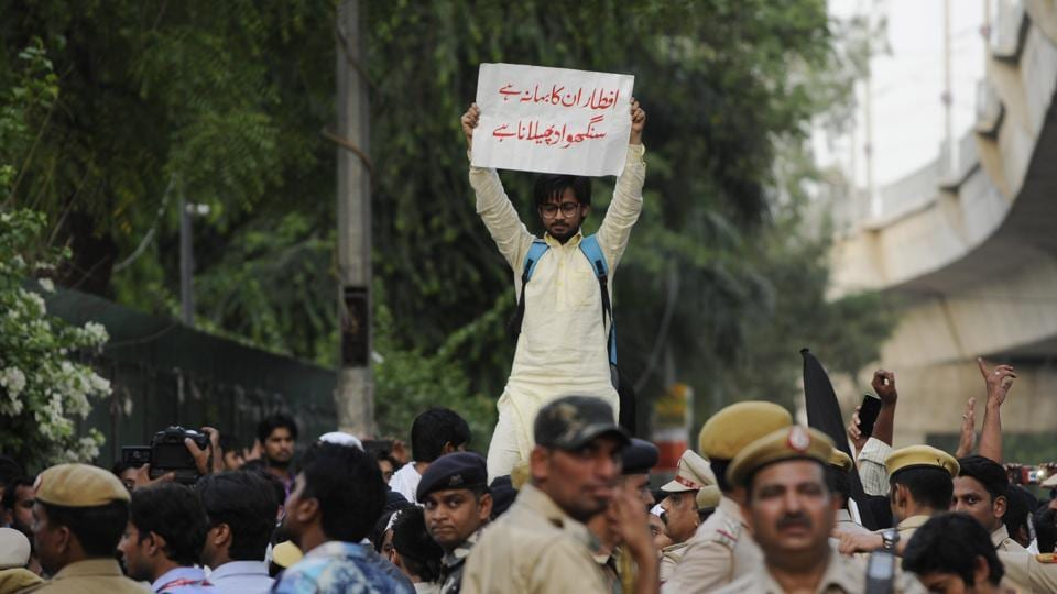 Students at Jamia Milia Islamia University stage a protest against the Iftar party organised by RSS Muslim faction, Rashtriya Muslim Manch, in New Delhi on Monday.