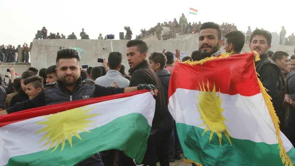 Kurdish residents hold flags during Norouz celebrations in Kirkuk, north of Baghdad March 20, 2016.
