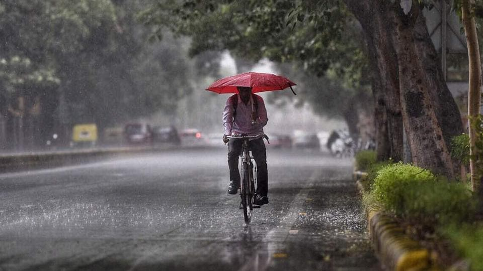 Swept by heat waves, people received much relief with a temperature drop of nearly two degrees and rain in various parts of the country. According to IMD, India is expected to receive 98% average annual rainfall this year. By the end of this month, the whole country is expected to be drenched with heavy rainfall as the monsoon season progresses. (Ravi Choudhary  / Ht Photo)