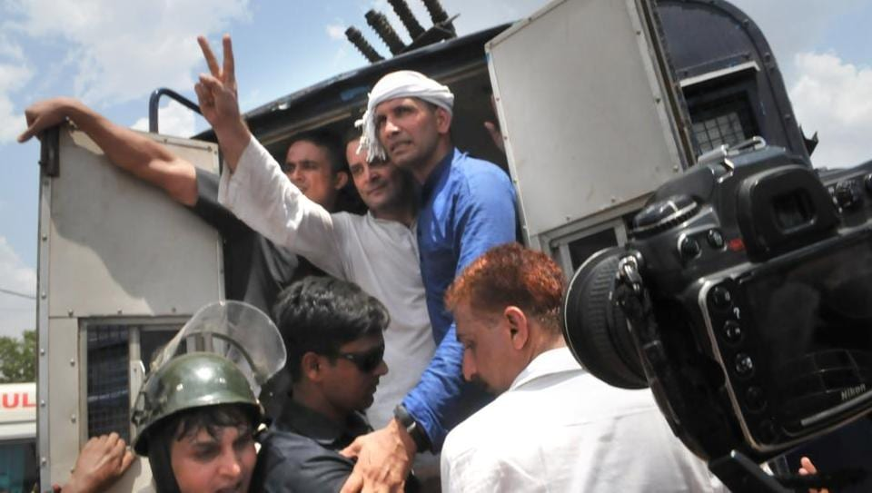 Congress vice-president Rahul Gandhi, who was accompanied by more than 100 supporters, was detained on Thursday as he tried to enter Mandsaur.  High political confrontation was seen on Thursday as Congress vice-president Rahul Gandhi was arrested after attempting to jump a barrier to enter the town rocked by violent farmer protests over loan waivers and better crop prices. (MUjeeb Faruqui / Ht photo)