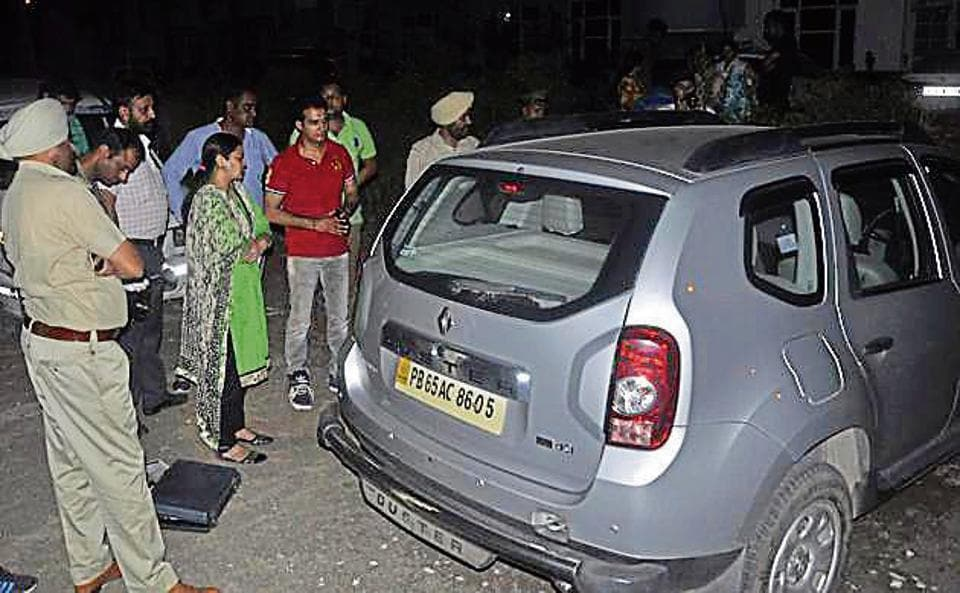 The forensic team of the Panchkula police taking fingerprints from car in Zirakpur's Ajit Enclave area on Thursday.