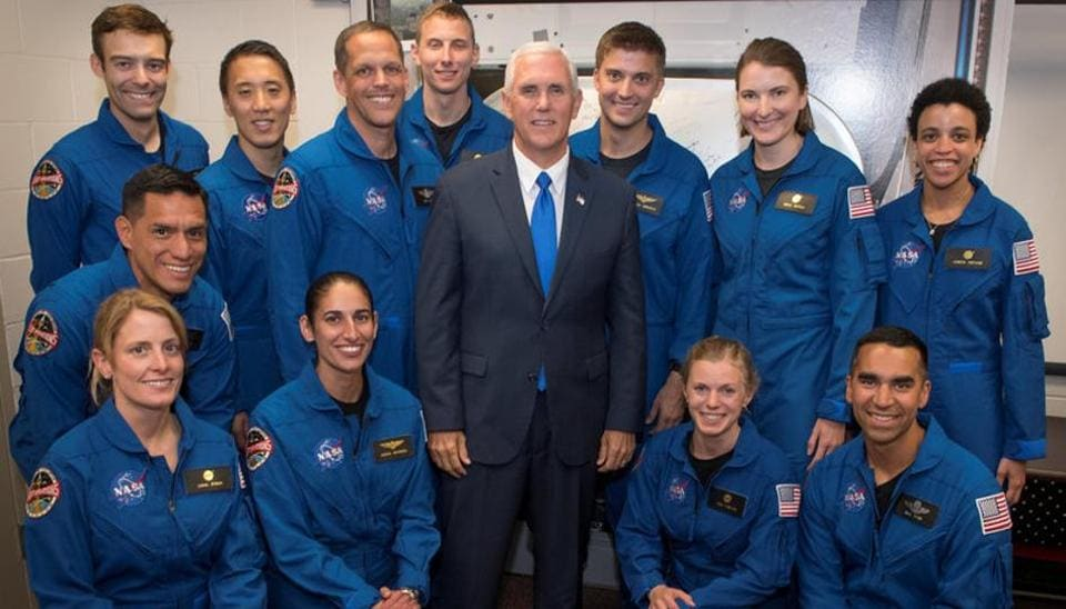US Vice-President Mike Pence poses for a group photograph with NASA's 12 new astronaut candidates at NASA's Johnson Space Center in Houston. Indian American Raja Chari is kneeling on the extreme right.