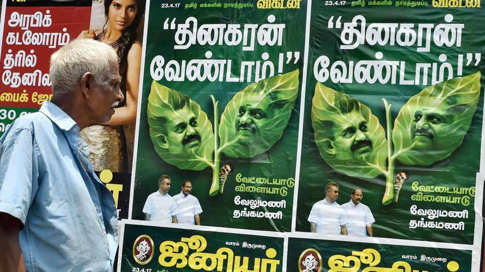 A poster of a popular magazine depicts the factional feud going on in the AIADMK.