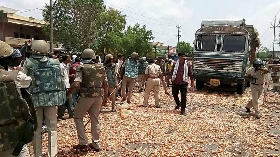 Farmers throw onions and other vegetables on the road during their protest in Shajapur on Thursday.