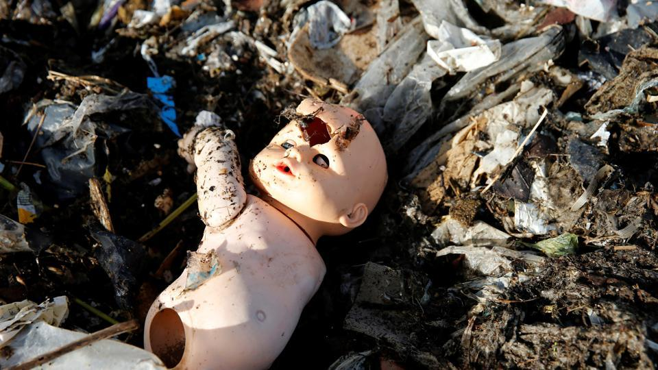 A plastic doll in debris at a landfill in Montevideo, Uruguay. Plastic debris is a constant risk to the delicate balance of life in corals already  under threat from climate change. Secretary-General Antonio Guterres on Monday, June 5, 2017, opened the first-ever UN conference on oceans with a warning that the lifeblood of the planet is 'under threat as never before,' with one recent study warning that discarded plastic garbage could outweigh fish by 2050 if nothing is done. (Andres Stapff/REUTERS)