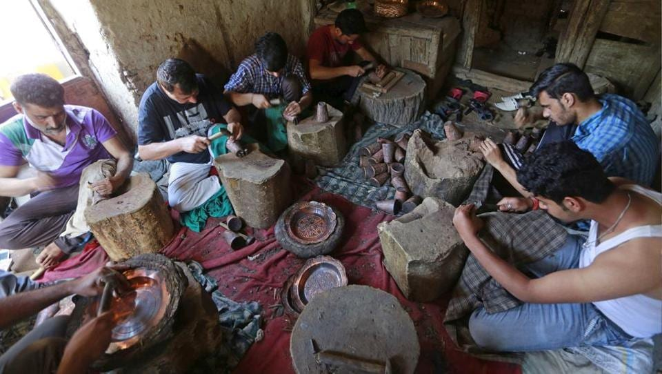 A large range of crockery products are made out of copper in Kashmir, including samavars (tea kettle), pots, glasses, jugs, plates, serving bowls, cooking pots. (Waseem Andrabi/HT Photo)