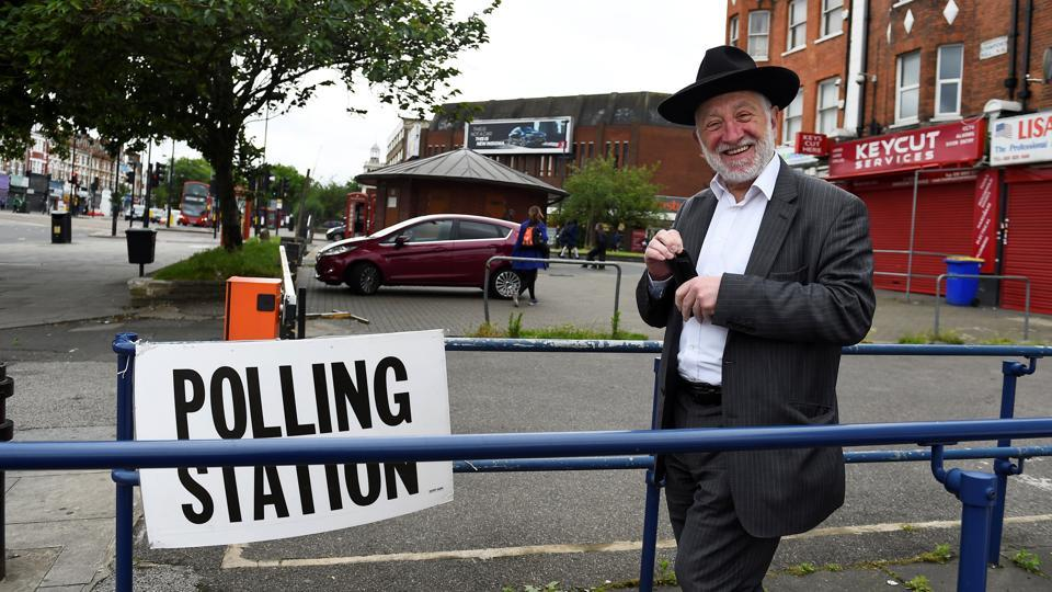 A voter leaves a polling station in Stamford Hill.  Polls will remain open from 7am to 10pm (0600GMT to 2100GMT) as voters choose 650 lawmakers for the House of Commons. (Clodagh Kilcoyne / REUTERS)