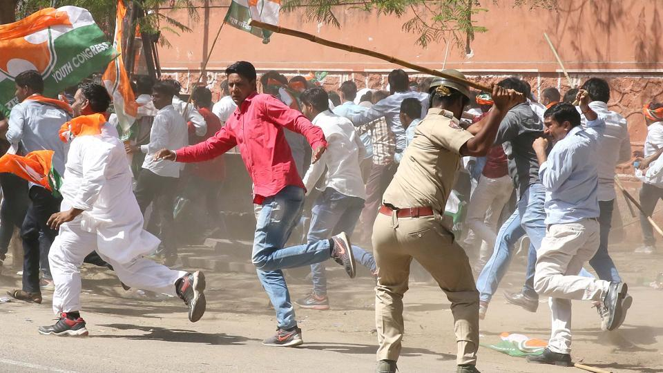 Police officials use force to disperse an aggressive rally of Youth Congress supporters and members demanding waiver of farmers' loans near the state assembly, in Jaipur, Rajasthan in May. (himanshu vyas/ht photo)