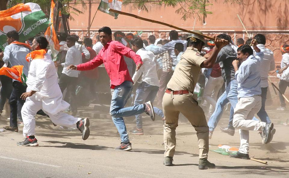 Police use force to disperse activists of Youth Congress, demanding waiver of farmers' loans, in Jaipur.