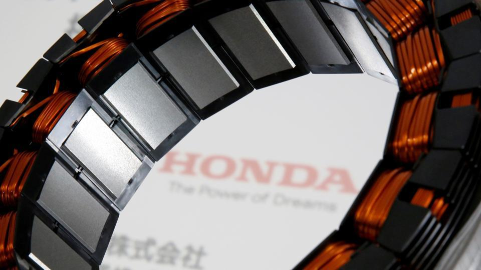 A unit for the i-DCD drive motor, the world's first electric motor for hybrid cars that uses no heavy rare earth metals, jointly developed by Honda Motor Co. and Daido Steel Co., is displayed at an unveiling in Tokyo.