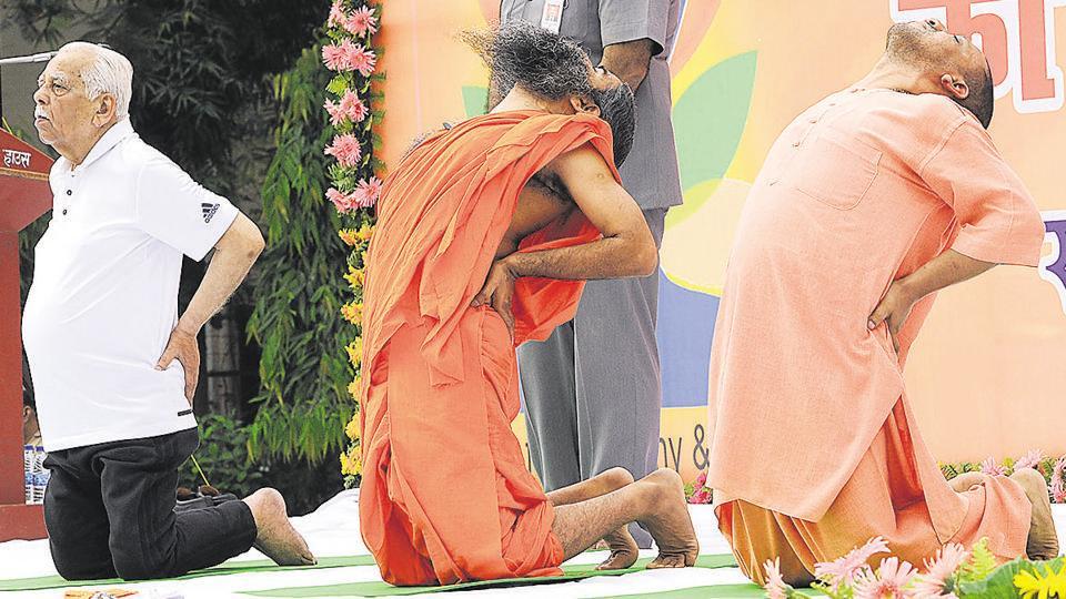 UP Governor Ram Naik, CM Yogi Adityanath practise yoga with Baba Ramdev  in a yoga session at Raj Bhawan,Lucknow.
