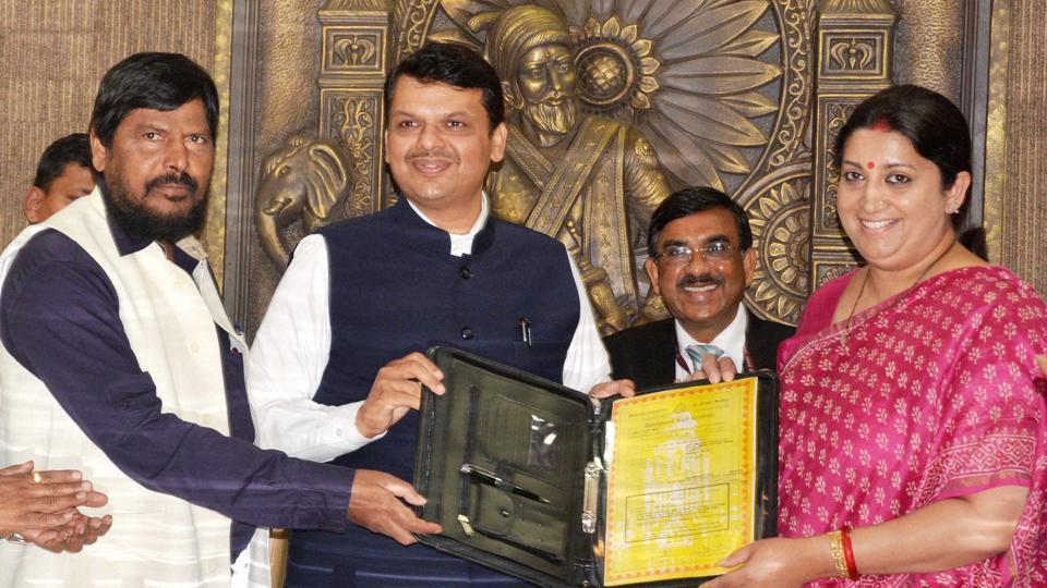 Union textiles minister Smriti Irani (right) hands over land documents to CM Devendra Fadnavis and minister of state for social justice Ramdas Athawale at Vidhan Bhavan  in March.