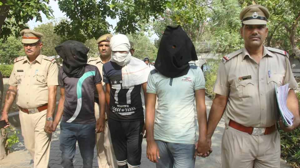 Police taking all three accused in the gang rape case of a woman and murder of her infant daughter to a court in Manesar area of Gurugram on Thursday.