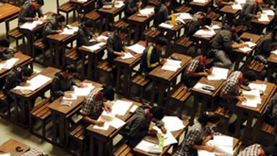 Schoolchildren take the Class 12 board exam at St Paul School in Indore on Monday. (Arun Mondhe/HT photo)