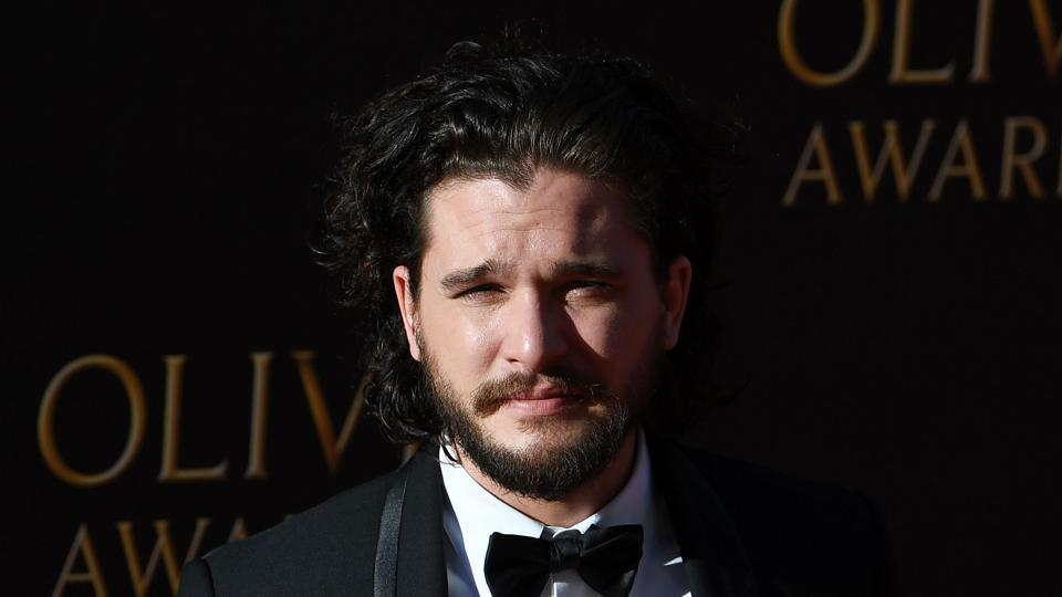 British actor Kit Harington poses on the red carpet upon arrival to attend the 2017 Laurence Olivier Awards in London.