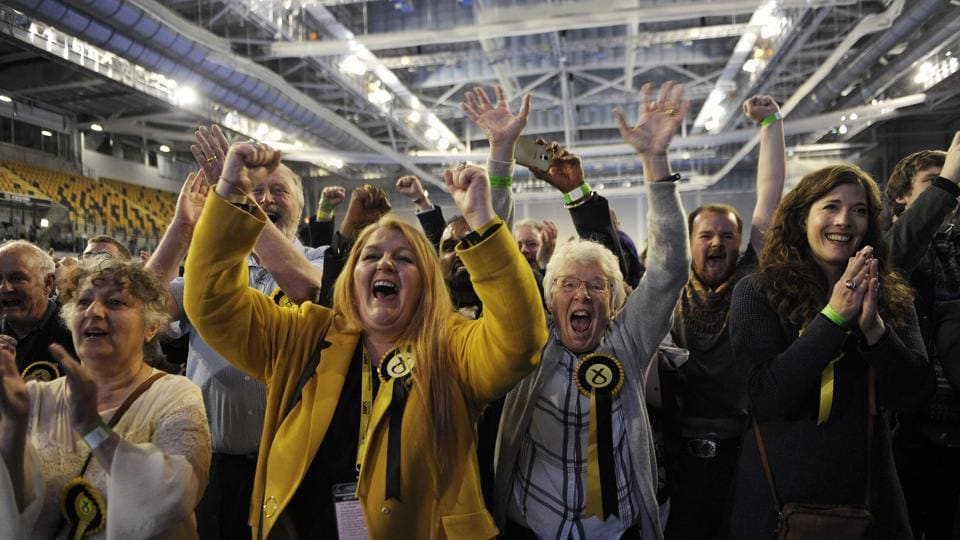 Scottish National Party (SNP) activists celebrate at the main Glasgow counting centre hours after the polls closed in Britain's general election. (Andy Buchanan/AFP)