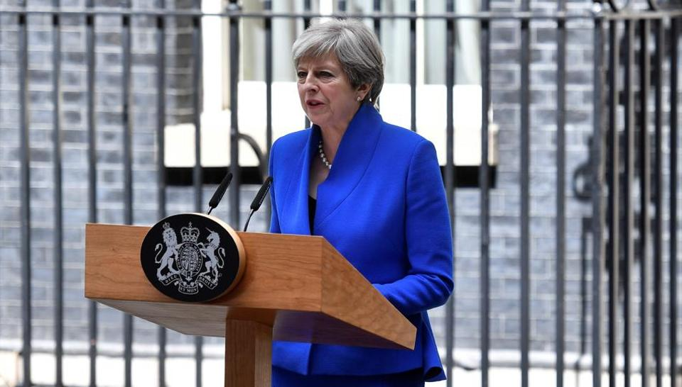 Britain's Prime Minister and leader of the Conservative Party Theresa May delivers a statement outside 10 Downing Street in central London.