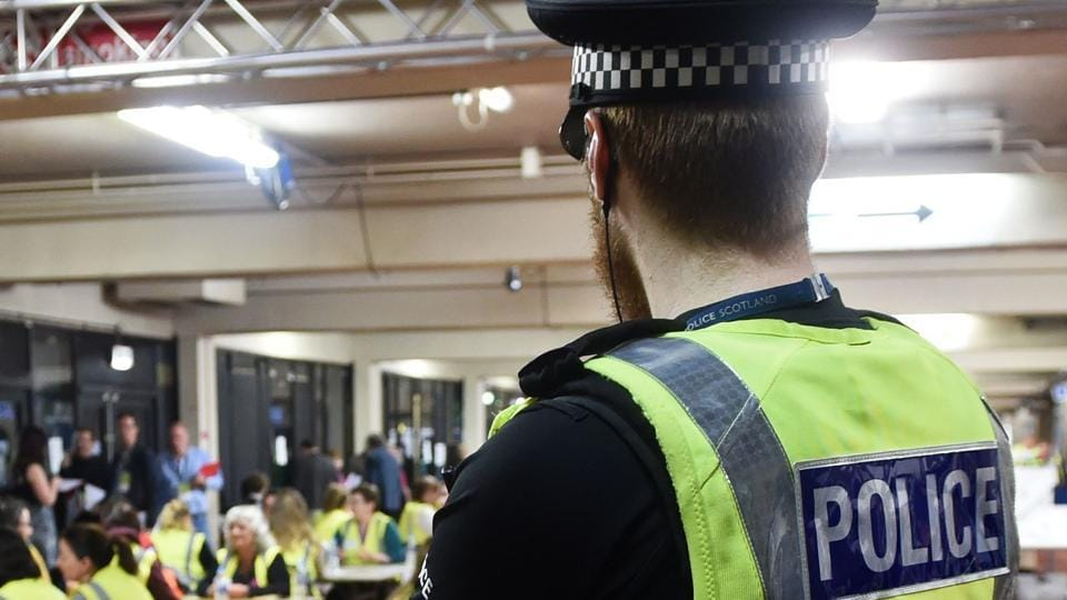 A man armed with a knife is holding employees hostage at a job centre in Newcastle in northeast England, police said on Friday.