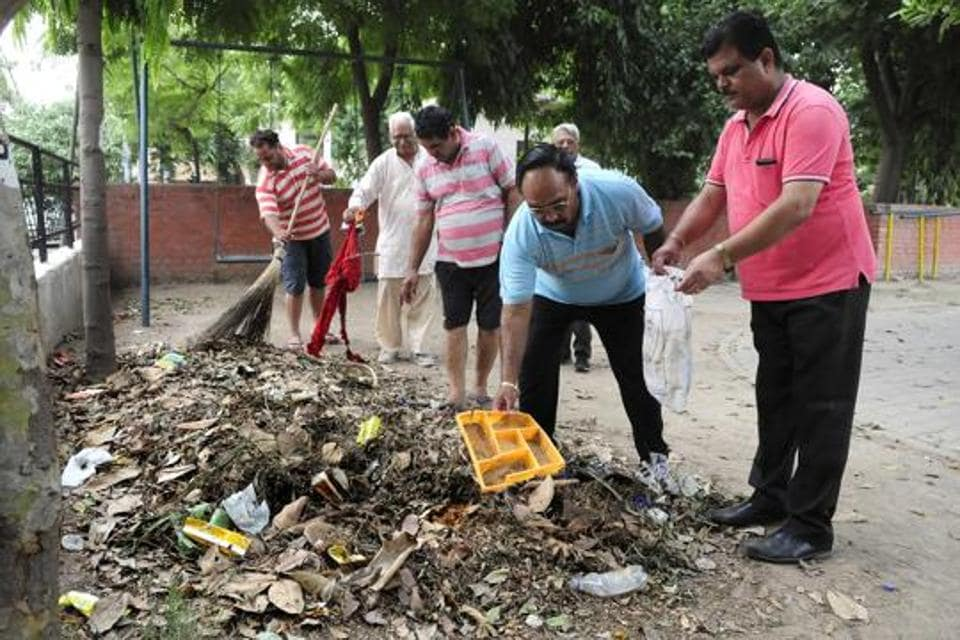 Members of Resident Welfare Association, Sector 47, Chandigarh, during a cleanup drive at the green belt in the sector earlier this week. The residents take great pride in keeping the public spaces clean.