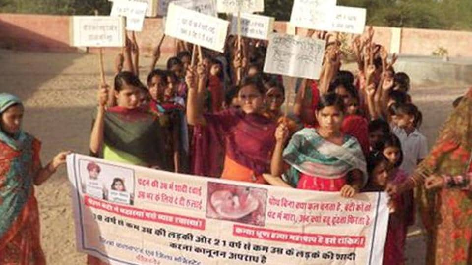 Children take part in a rally to create awareness on child marriage