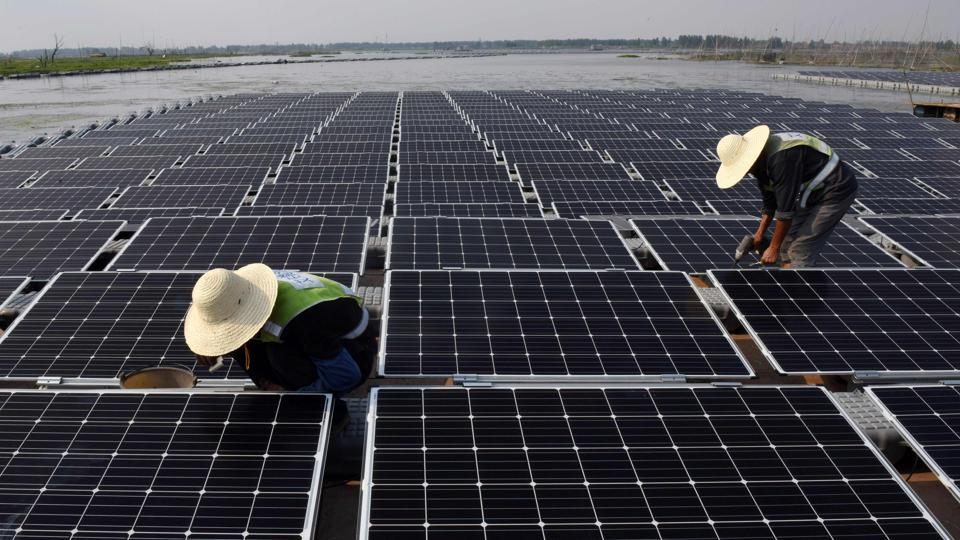 Workers working at the world's largest floating solar power plant in a lake in Huainan, in China's central Anhui province. TChina is now the home to the world's largest floating solar power plant. According to techstory.in, the power plant is now operational in Eastern China's Huainan city in the Anhui province.  (AFP)