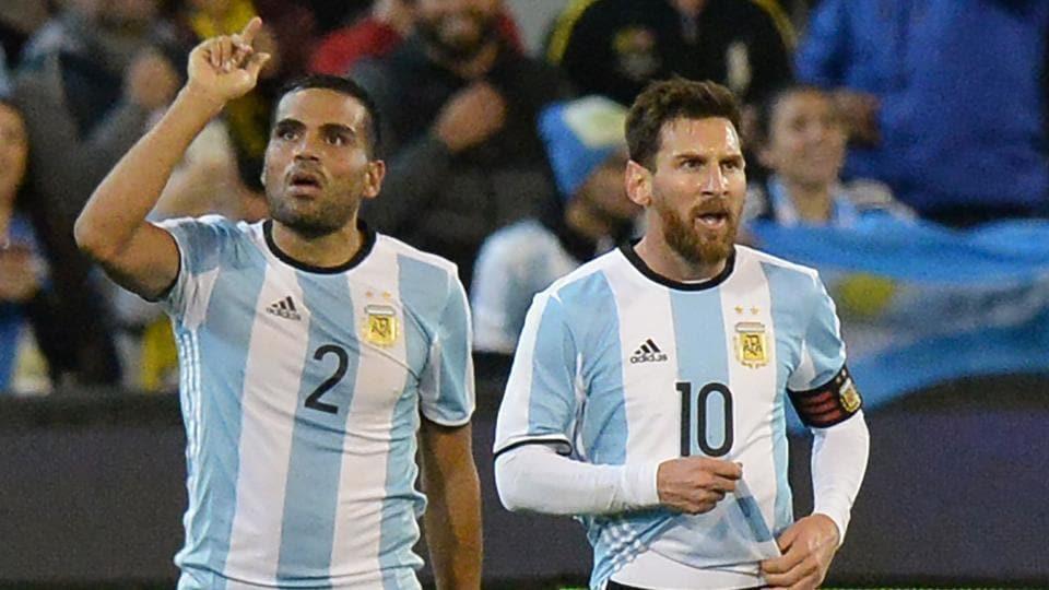 Argentina's Gabriel Mercado (L) celebrates a goal with Lionel Messi.