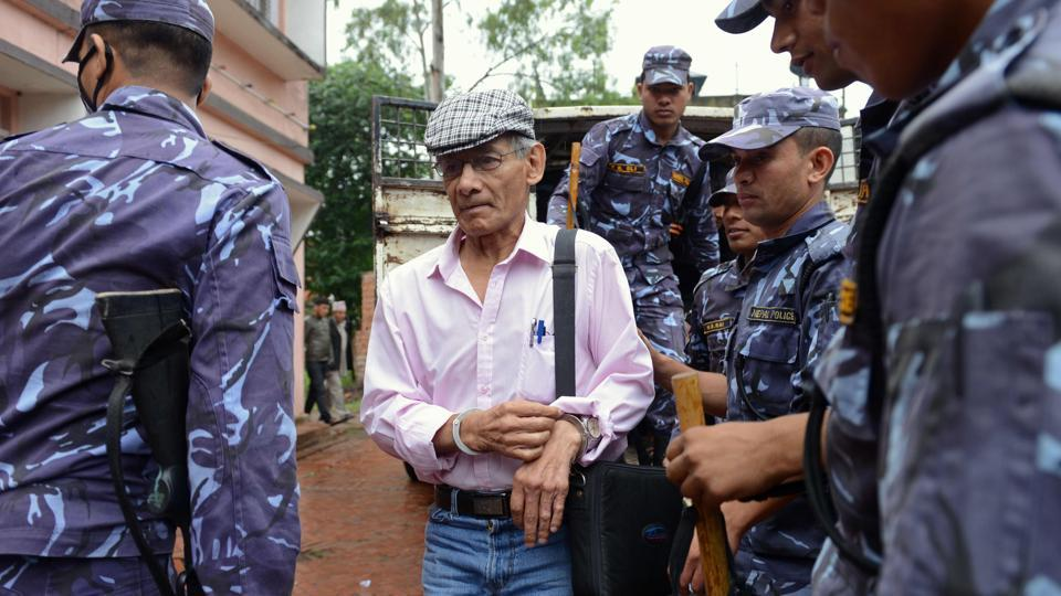 French serial killer Charles Sobhraj (centre) being brought to the district court for a hearing on a case related to the murder of Canadian backpacker Laurent Ormond Carriere, in Bhaktapur on May 26, 2014.