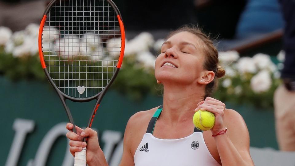 Romania's Simona Halep celebrates winning her French Open semi final match against Czech Republic's Karolina Pliskova.