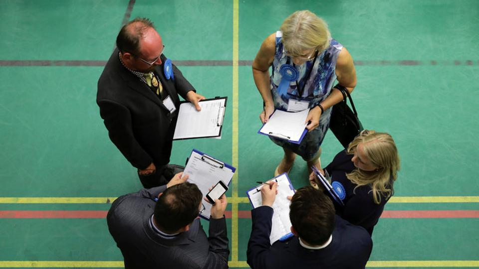 Party activists wait at a counting centre for Britain's general election in Hastings. Shock exit polls have disrupted the expectations of the Conservatives strengthening their majority in the parliament ahead of scheduled Brexit talks later this month.  (Kevin Coombs/REUTERS)