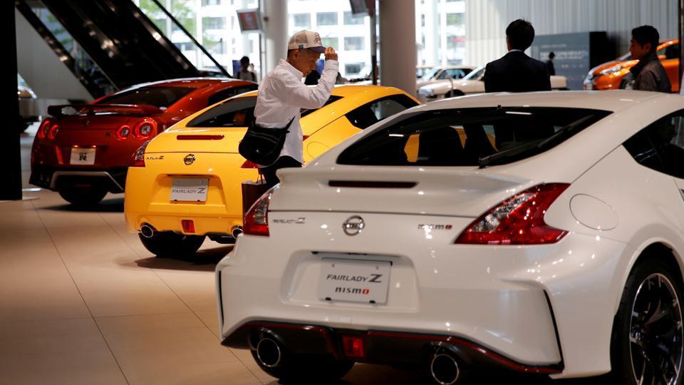 A man walks in the Nissan showroom at the carmaker's headquarters in Yokohama.