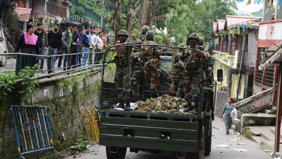 Army personnel patrol the streets on Friday after clashes between police and GJM supporters in Darjeeling. (DIPTENDU DUTTA / AFP)