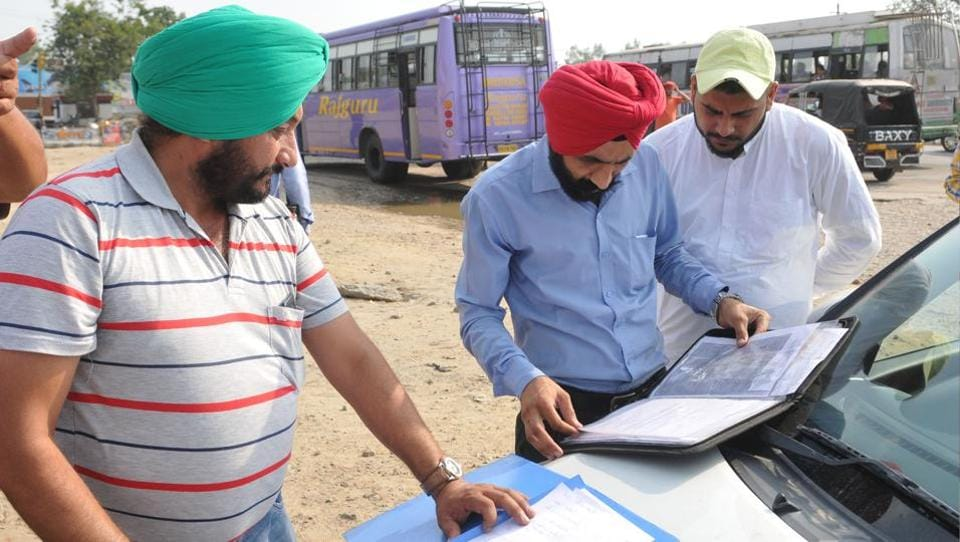 Vigilance officials checking documents of buses at PAP Chowk in Jalandhar on Friday.