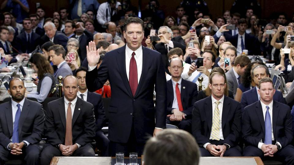 Former FBI Director James Comey is sworn in during a Senate Intelligence Committee hearing on Thursday in Washington.