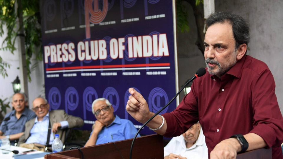 NDTV founder Prannoy Roy addresses a protest meeting at Press Club of India in New Delhi on Friday against the CBI raids on his news channel in an alleged financial fraud case.