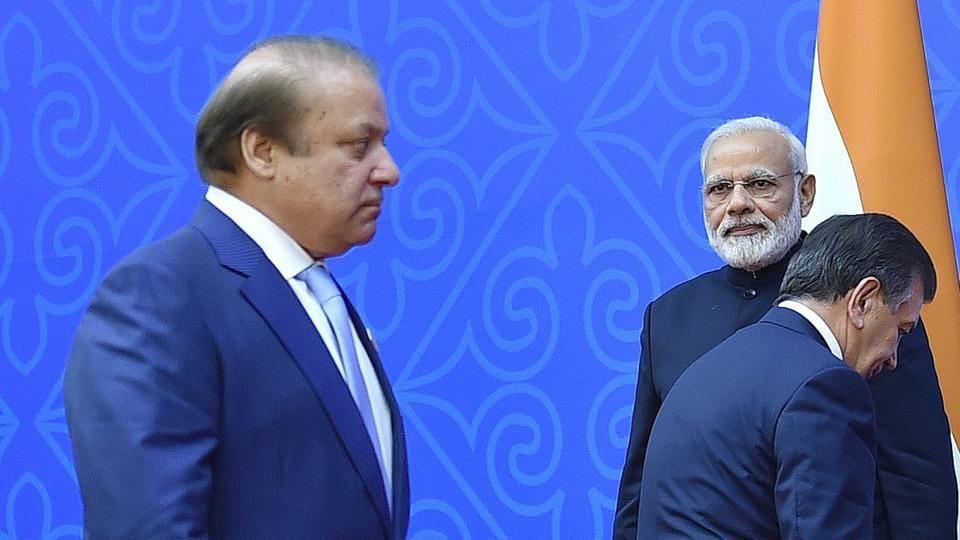 From L: Pakistani Prime Minister Nawaz Sharif, Indian Prime Minister Narendra Modi and Uzbek President Shavkat Mirziyoyev gather for a family photo at the Shanghai Cooperation Organisation (SCO) Summit in Kazakhstan's capital Astana on June 9, 2017.